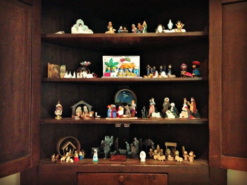 Mom's 'instant Christmas' display of nativity scenes from South America, Europe, North Africa, and Asia.